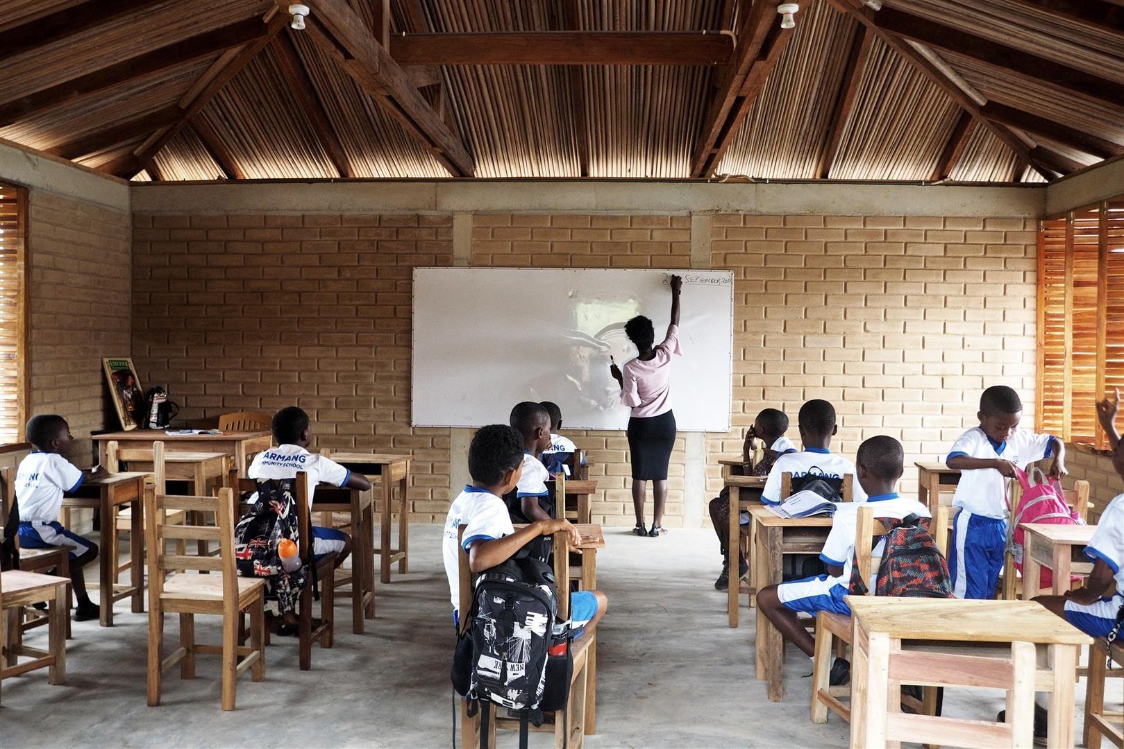 the teacher writes on the blackboard