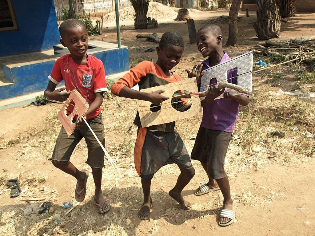 children playing with home-made instruments